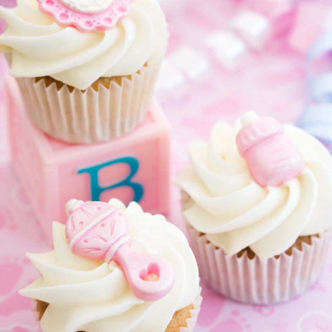 Cupcakes decorated with a baby girl theme